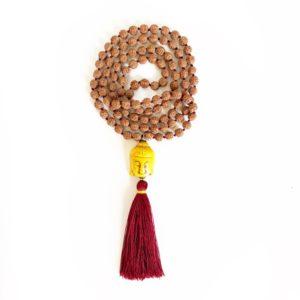 Mala in semi di rudraksha e Buddha giallo